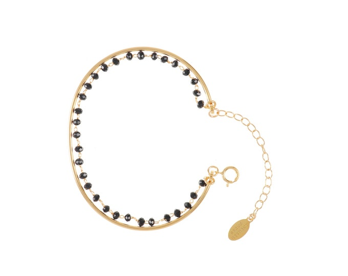 Gold Bangle lined with a black tinted glass beads - a Paris chain