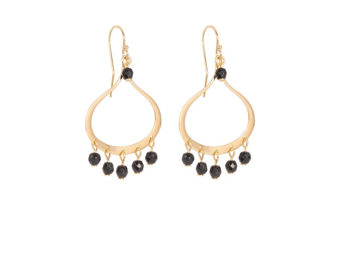 Dangling earrings with black tassels gilded with fine gold