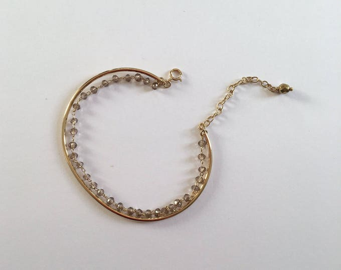 Gold Bangle lined with a gold tinted glass beads - a Paris jewelry chain