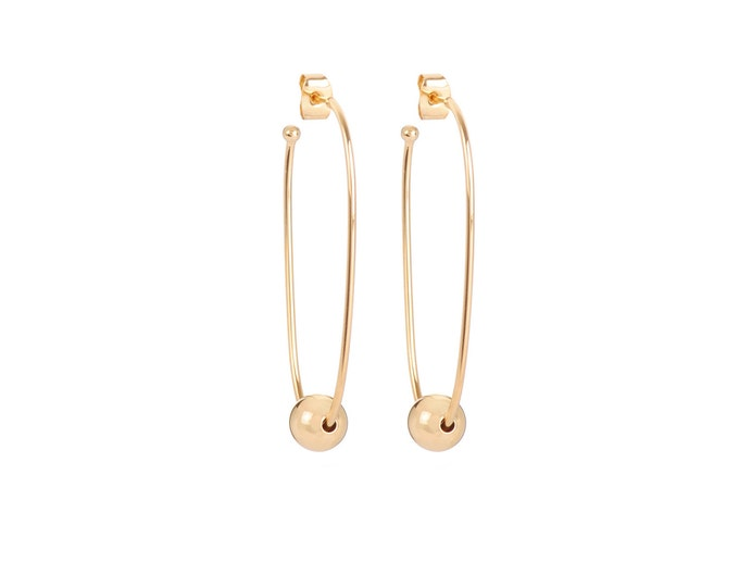 Long golden JULIETTE earrings with a golden ball