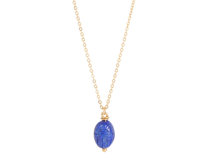 """Gri gri necklace with a scarab pendant in lapis lazuli on a cable chain and the number """"7"""" on the clasp"""