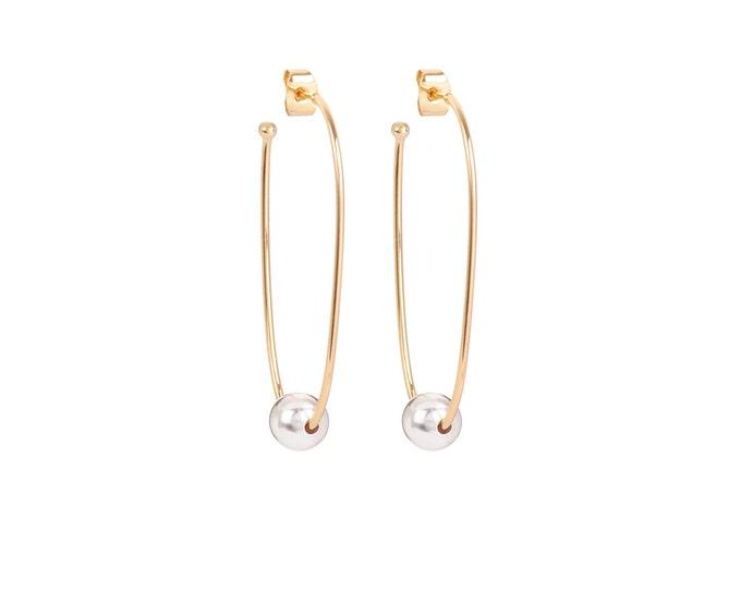 Long golden JULIETTE earrings with a silvered ball