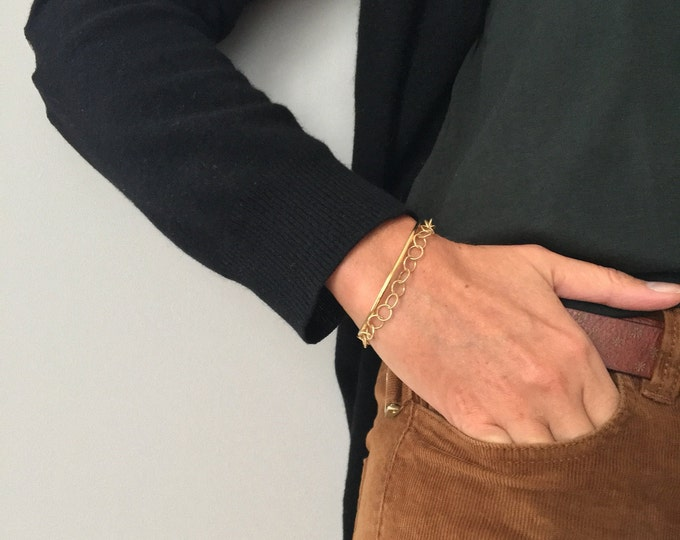 Golden Rigid bracelet, lined with a chain of large rings - Intuitu Paris