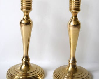 Beautiful pair of candlestick candle holders solid brass. Absolutely adorable! Excellent!