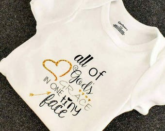 Adorable baby body suit..all of God's grace in one tiny face