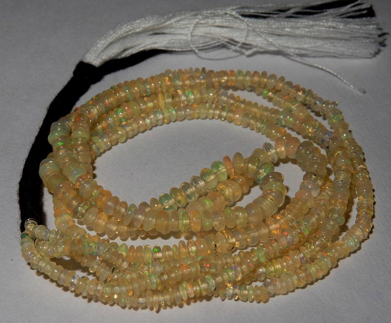 Amazing Fire Natural Ethiopian opal Roundel Beads 2 to 4 MM Size Superb Fire Welo Fire Opal Beads 16 inch long Strand In low Prize