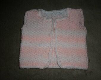 Pink sleeveless vest
