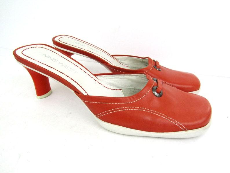 662a627d7e443 sz 7 | vintage 90s Nine West orange leather slip on mules sporty y2k mule  sandals vintage 90s mule sandals vintage orange heels 90s sandals