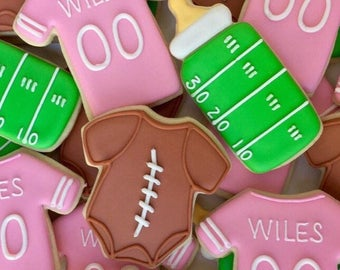 Football themed baby cookies