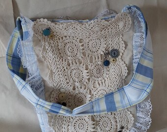 Handbag made of vintage crocheted doily and embroidered piece