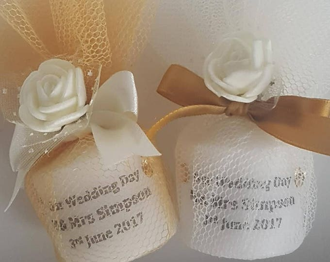 Personalised wedding candle favours wrapped in tulle. Gold, silver or ivory  with a flower embellishment