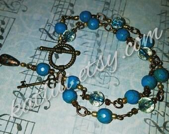 Turquoise bead and bronze bracelet