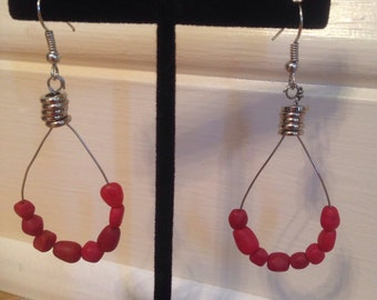 Red dangle hoop earrings