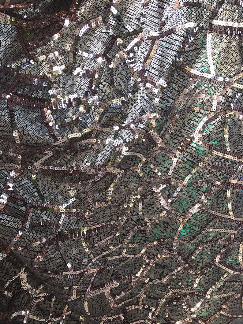 Spider design rose gold sequins 2-size all over on spandex mesh base 5556 Sold by the yd ships worldwide from Los Angeles California USA.