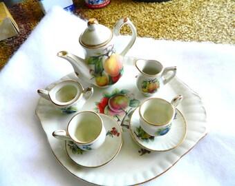 vintage 9 piece miniature tea set gold trim with flowers cups saucers cream sugar pot