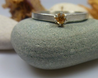fire opal and prong setting