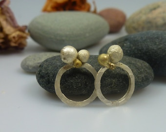 symbol of infinity, the circle, stud earrings.