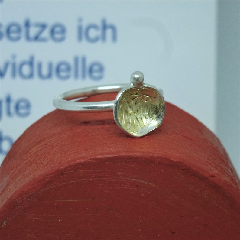 smal silver ring FLORES. image 0