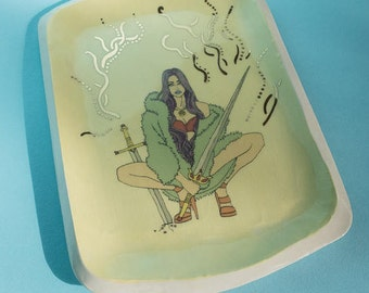 handmade illustrated ceramic sword witch tray.