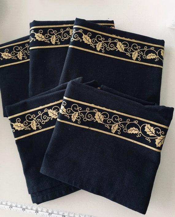 Tea towel decorated with gold metallic border