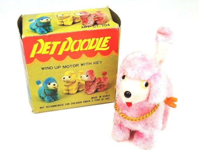 Vintage Pink Pet Poodle Wind Up Motor with Key Toy bt