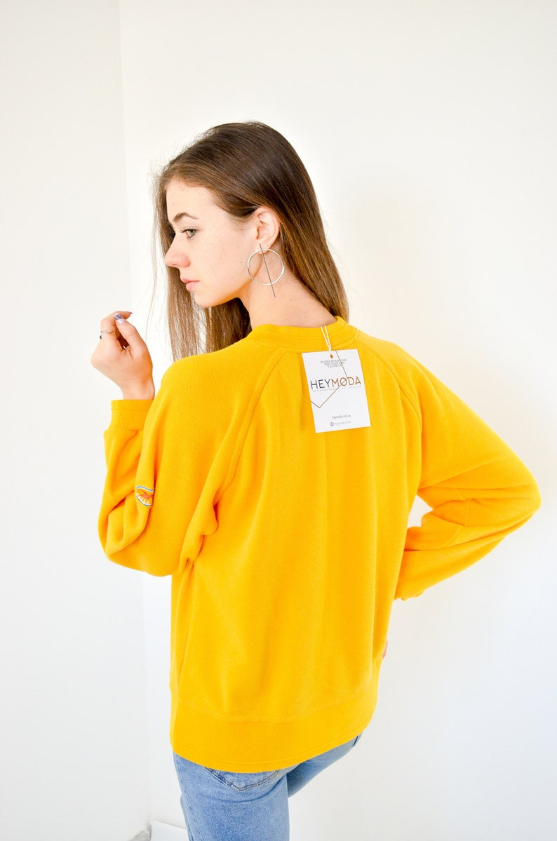 4f33da75e1808 Vintage Women's Reebok Yellow Logo Sweatshirt Size S