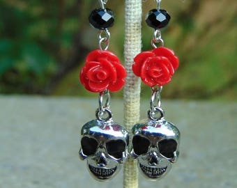 Day of the dead/ Halloween themed earrings, with metal skull charms, red roses, and black crystals
