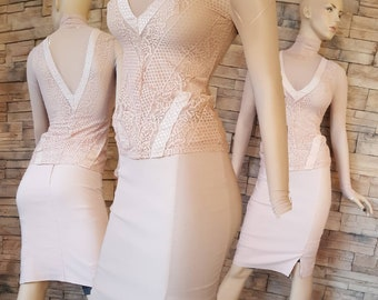 Peach body hugging pencil skirt and lace sweater