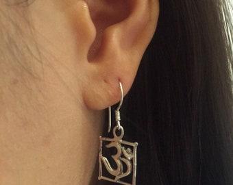OM sterling silver earrings