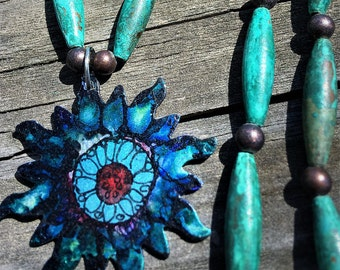 Ink hand  painted sun pendant, and copper patina beaded necklace.
