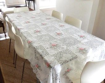 Vintage tablecloth alternating sheer fabric squares of floral embroidery with  squares of crocheted lace giving it a patchwork look.