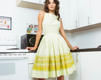 Pear Cake Dress | 1950s Vintage Myra Janet Border Print Spaghetti Strap Bows Nipped Waist Tulle-Lined Full Skirt Dress | Size XXS