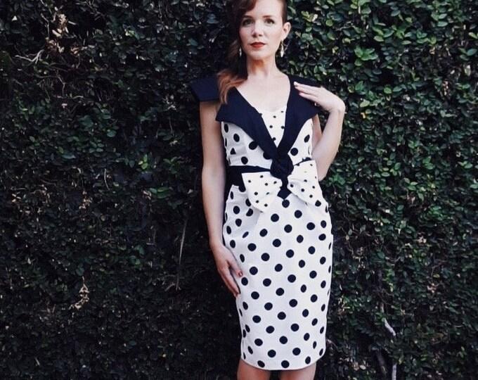Perdita Dress | 1980s Vintage Tuxedo Collar Black + White Polka Dot Oversized Bow Wiggle Dress | Size S/M