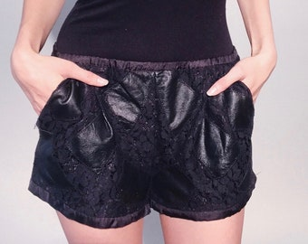 Stefani Shorts | 1980s Vintage Black Leather Lace Cutout Silky Lined Italian Hot Pants with Slant Pockets | Size S