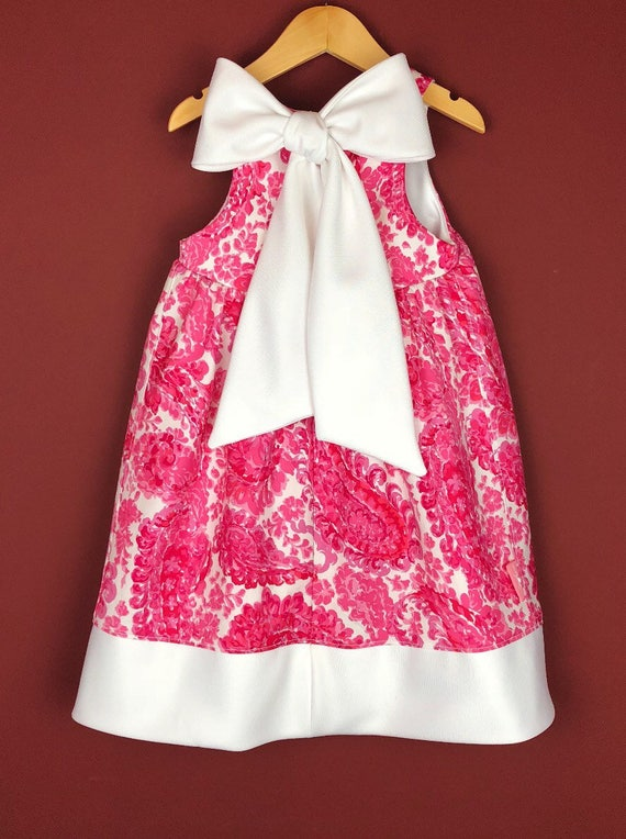 """The """"Bow-Backed Dress"""" in Pink Paisly."""