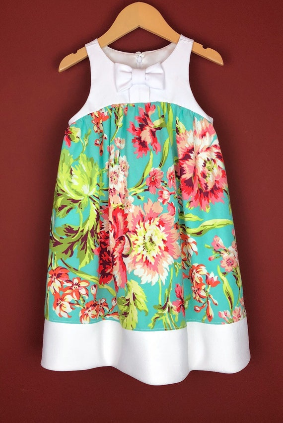 """The """"Bow-Tie Dress"""" in Aqua Floral."""