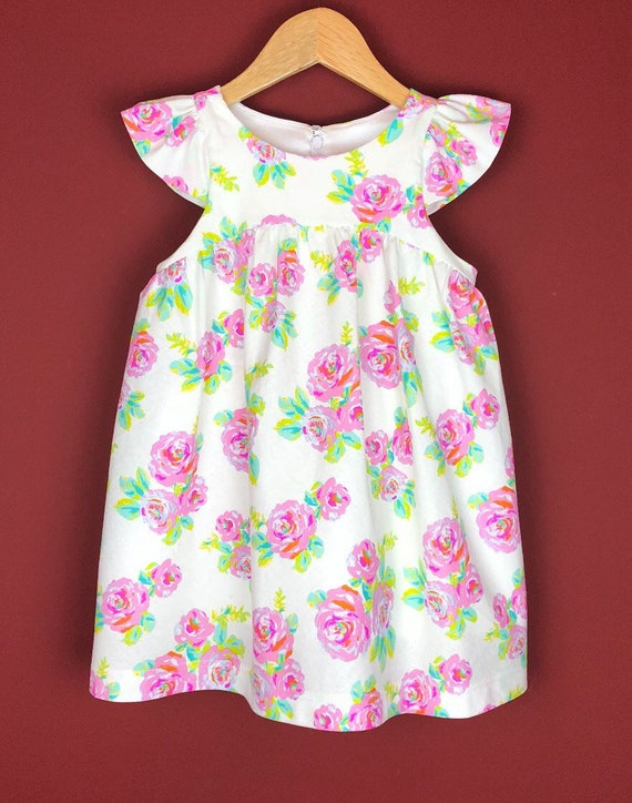 """The """"Flutter-By Dress"""" in Neon Rose."""