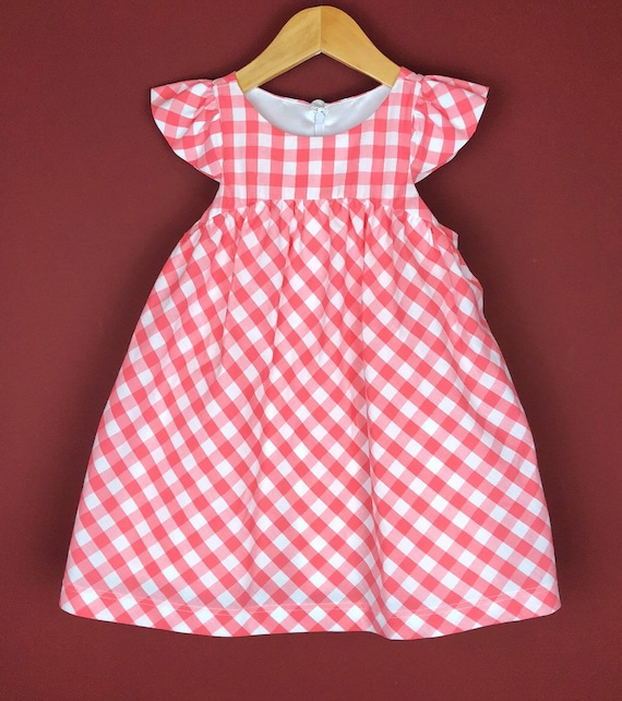 """The """"Flutter-By Dress"""" in Salmon Gingham."""
