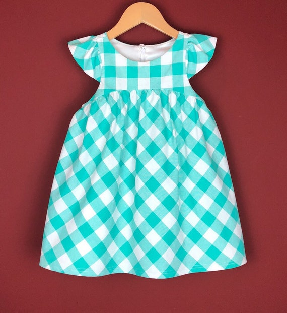 """The """"Flutter-By Dress"""" in Aqua Gingham."""