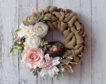 Burlap Wreath with pink and cream flowers and nest