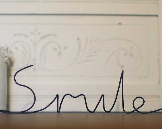 Wire art, freestanding 'Smile' sculpture. Handmade in handwritten font.