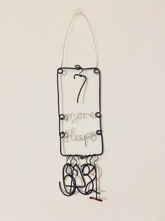 Seven-sleep Advent Countdown, handmade in black iron wire