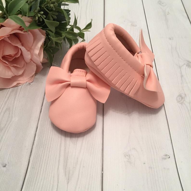 c486ca2e6dd89 Blush pink baby bow moccasins. Leather moccasins. Pink baby moccasins. Boho  baby. Leather baby shoes. Fringe moccasins.