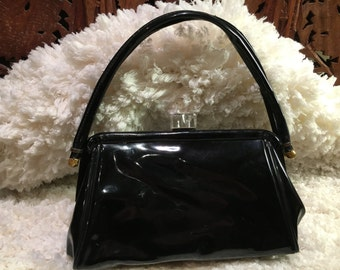 Vintage 1940's black patent handbag with clear lucite carved clasp