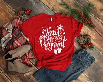 2ceab08d52049 Merry and Pregnant Shirt. Pregnant Shirt. Christmas Pregnancy Announcement  Shirt. Christmas Pregnant Shirt. Unisex Shirt. Mom Tee.