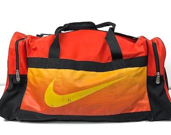 97ab8f60039d Beautifully Beat Nike Duffel Bag - Large Nike Swoosh Vintage Travel Bag  with Tote Handles   Shoulder Strap - Distressed Nike Athletic Bag