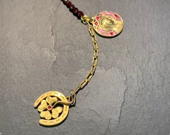 Y necklace with antique pendants and garnets