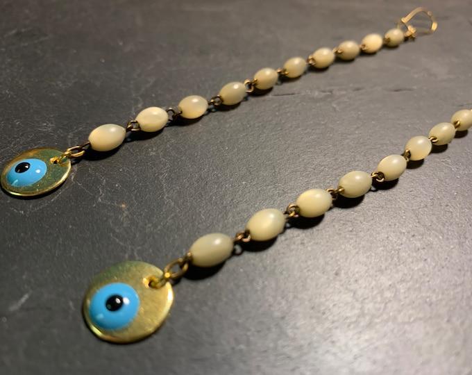 Long pendants in vintage rosary and Matiasma.