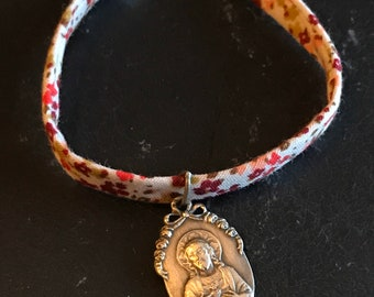 Liberty bracelet and Italian Holy Medal