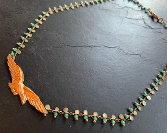 Vintage Sparrowhawk necklace on green beaded mesh